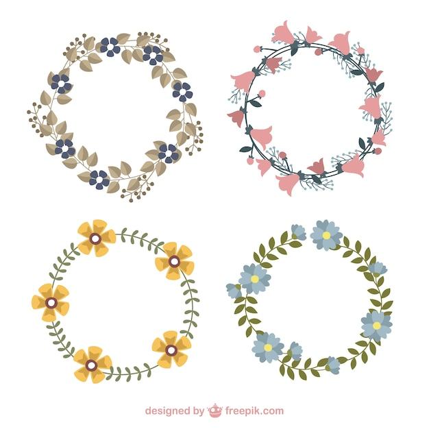 dessins la main des couronnes de fleurs mignons avec diffrentes fleurs vecteur gratuit