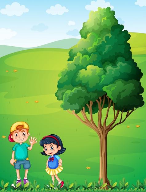 Deux enfants au sommet de la colline près de l'arbre Vecteur gratuit