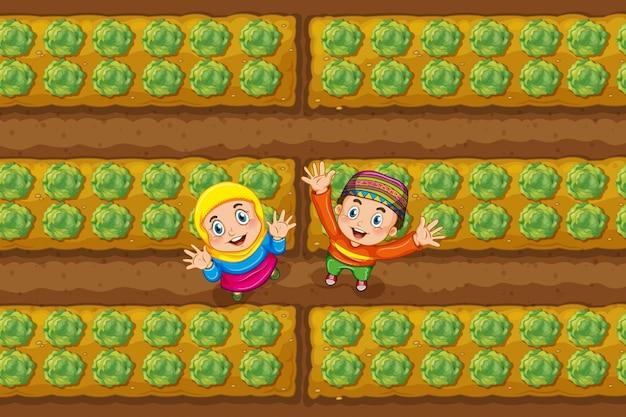 Deux enfants musulmans dans un potager Vecteur Premium