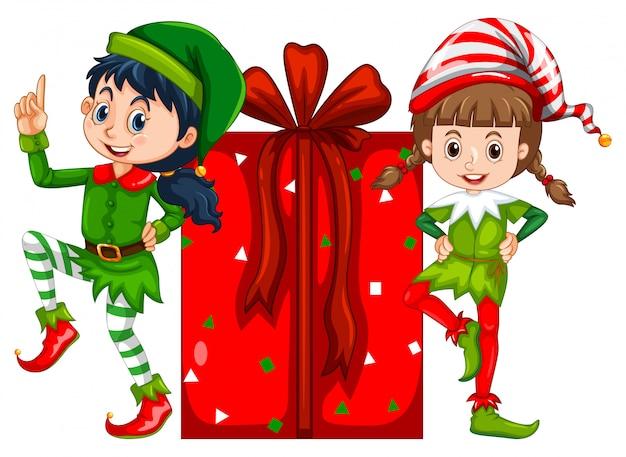 Deux filles habillées en costume d'elfe et boîte à cadeau rouge Vecteur Premium