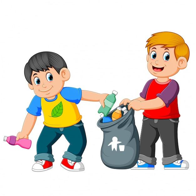 Deux garçons ramassant des ordures Vecteur Premium