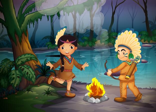 Deux jeunes indiens à la forêt Vecteur gratuit