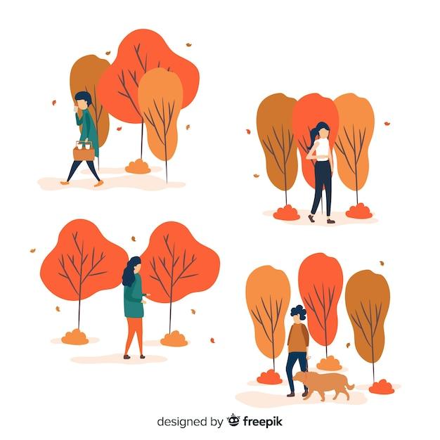 Différentes personnes marchant en automne Vecteur gratuit