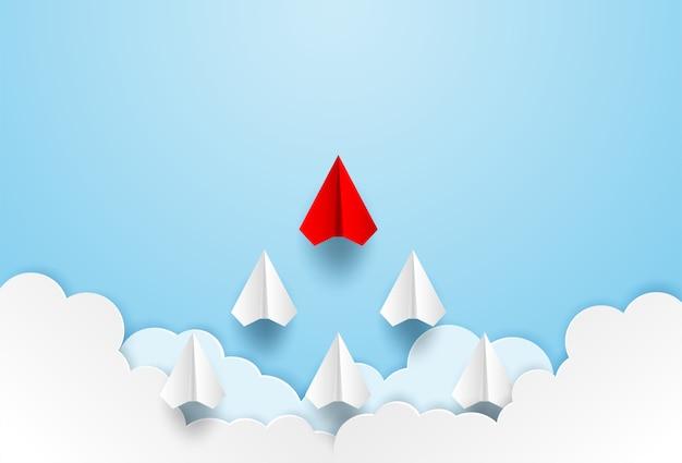 Direction de l'avion en papier rouge au ciel Vecteur Premium