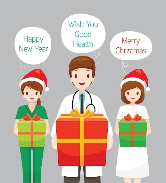 Docteur Et Infirmière Voeux De Noël Vecteur Premium
