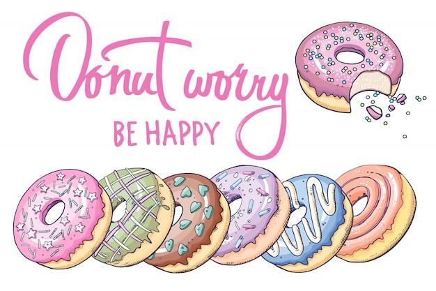 Donut worry, soyez heureux. lettrage avec beignets et inscription. Vecteur Premium