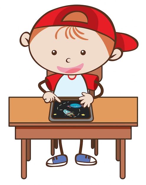 Doodle kid jouer tablette sur fond blanc Vecteur Premium
