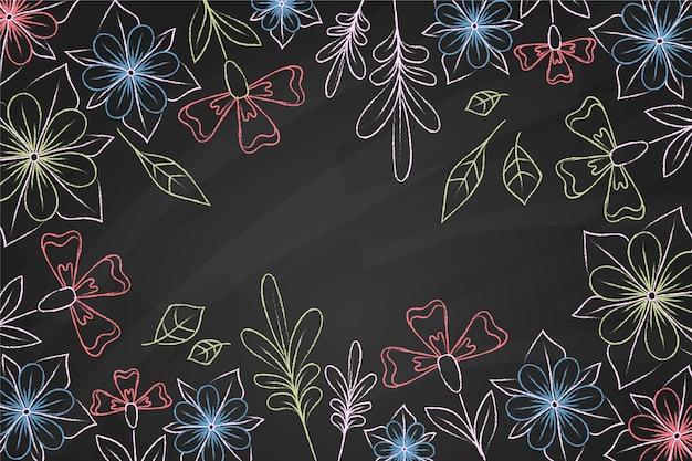Doodles De Fleurs Sur Fond De Tableau Noir Vecteur gratuit