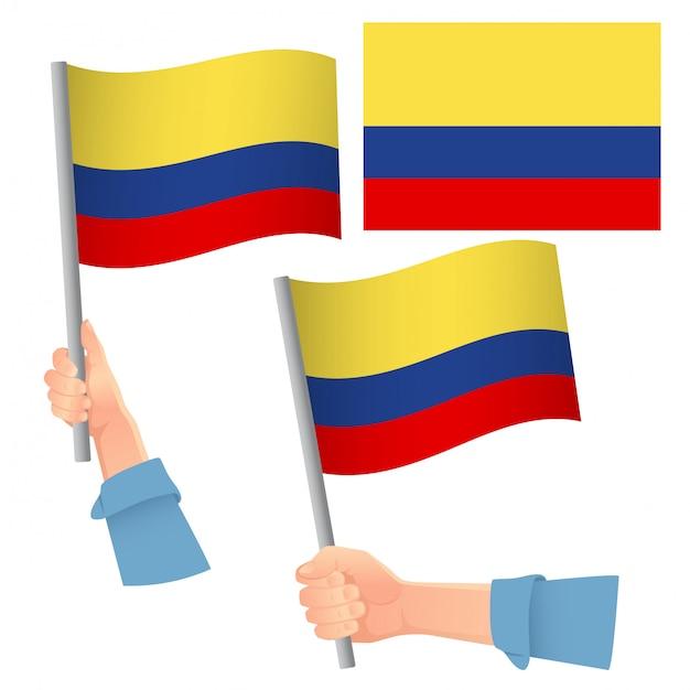 Drapeau De La Colombie En Jeu De Main Vecteur Premium