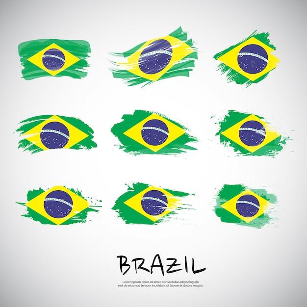 Drapeau du brésil avec coup de pinceau. Vecteur Premium