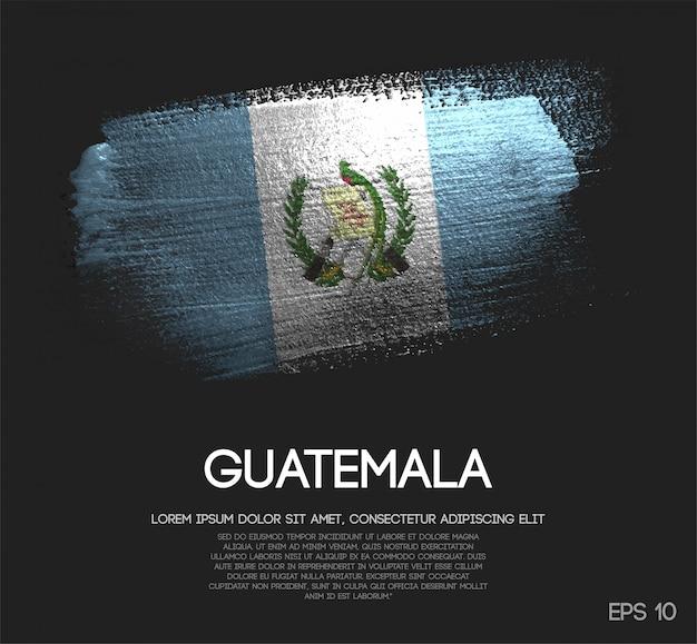 Drapeau de guatemala fait de peinture de pinceau d'étincelle de scintillement Vecteur Premium