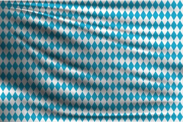 Drapeau d'oktoberfest sur tissu ondulé Vecteur Premium