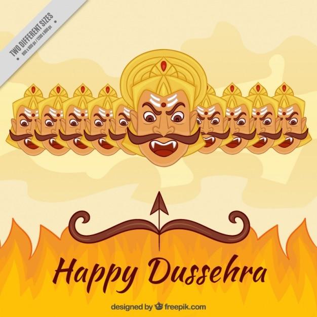 Dussehra fond avec le feu et les dix têtes de ravana Vecteur gratuit