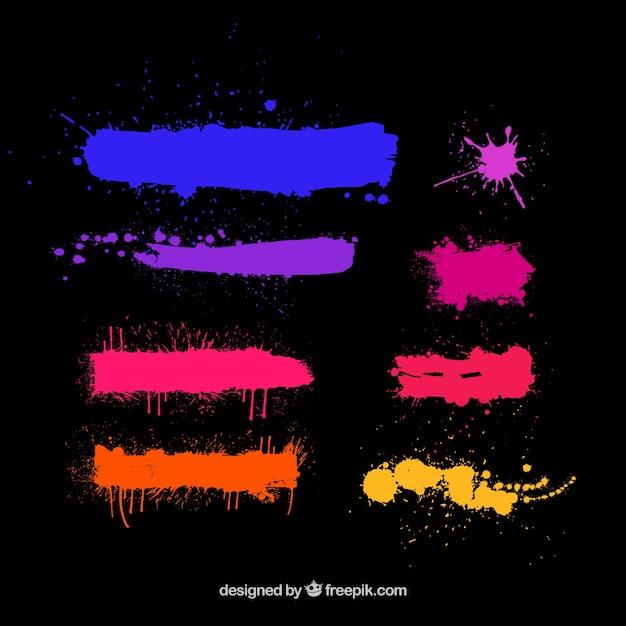 Éclaboussures de couleurs sur fond noir Vecteur gratuit