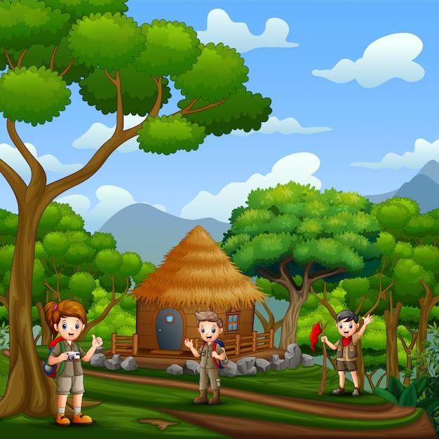 Les éclaireurs Devant Un Chalet En Bois Dans La Forêt Vecteur Premium