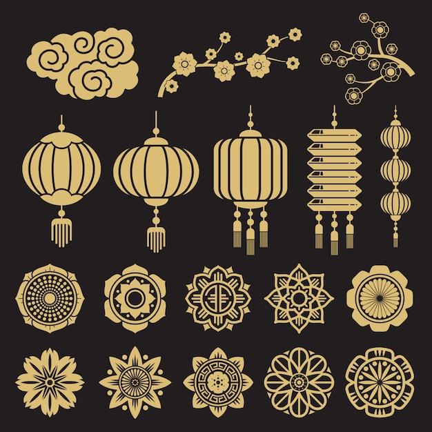 Éléments décoratifs chinois et japonais traditionnels isolés sur fond noir Vecteur Premium