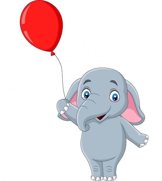 Éléphant en dessin animé tenant un ballon rouge Vecteur Premium