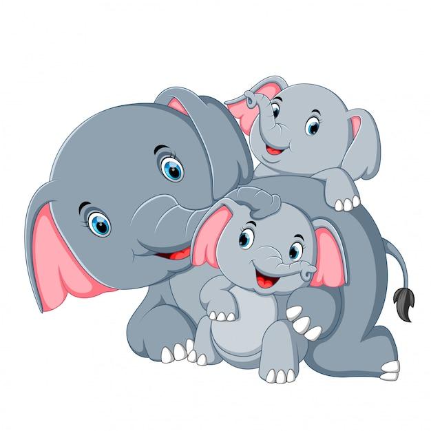 Un éléphant s'amuse avec sa famille Vecteur Premium
