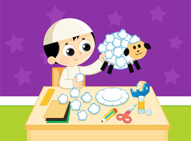 Un enfant musulman fabrique un mouton fabriqué à la main à partir de papiers colorés Vecteur Premium