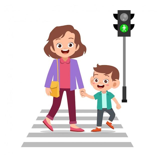 Enfant avec parent traverser la route Vecteur Premium