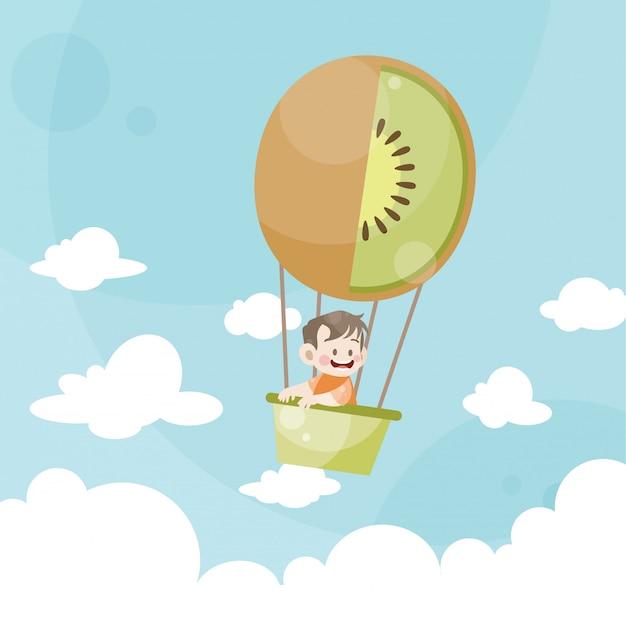Enfants dessinés sur un kiwi en montgolfière Vecteur Premium