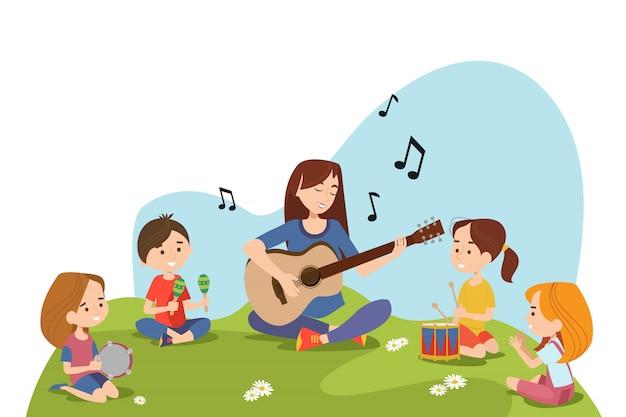 Enfants Et Enseignant Assis Sur L'herbe Et Jouant Vecteur gratuit