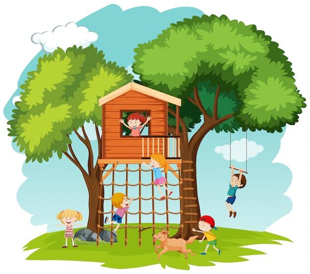 Enfants jouant dans la maison de l'arbre Vecteur Premium