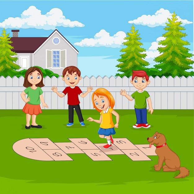 Enfants Jouant à La Marelle Dans Le Parc Vecteur Premium