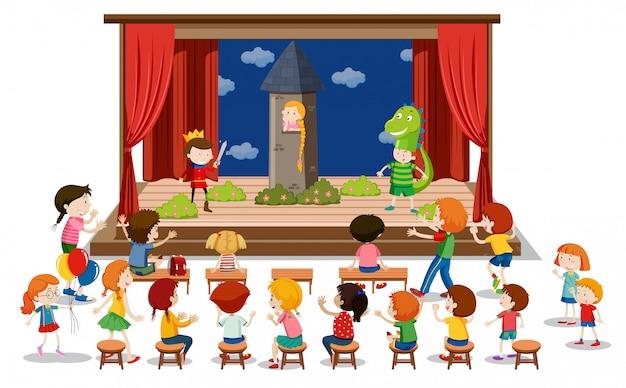 Les enfants jouent le théâtre sur scène Vecteur gratuit