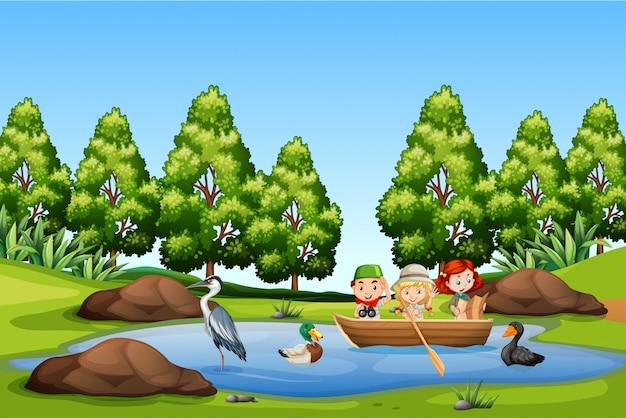 Enfants pédalo dans le lac Vecteur Premium