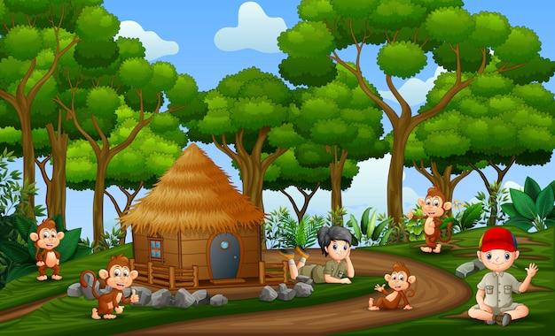Les Enfants Safari Avec Des Singes à La Campagne Vecteur Premium