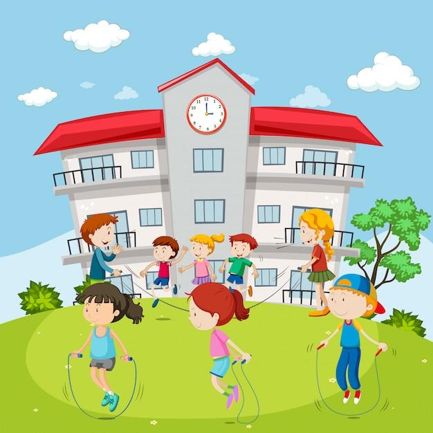 Enfants sautant à la corde à la cour d'école Vecteur gratuit