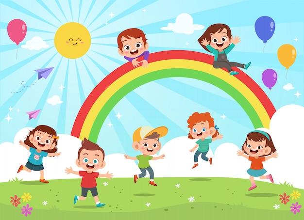 Enfants sautant sous le dessin animé coloré arc-en-ciel Vecteur Premium