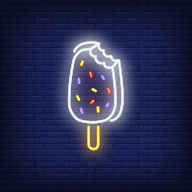 Enseigne au néon de barre de crème glacée mordue Vecteur gratuit