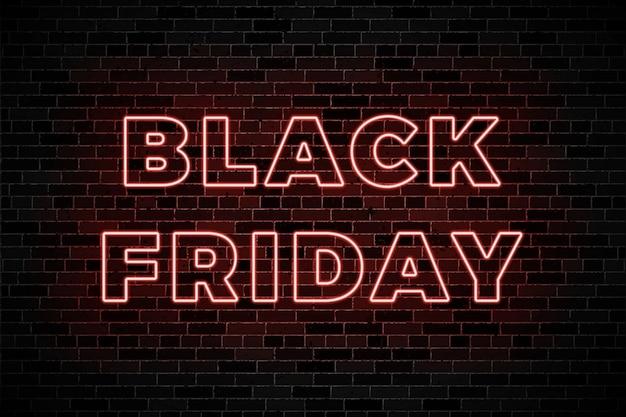 Enseignes de lueur de néon pour la vente de vendredi noir sur fond de mur de brique sombre Vecteur Premium