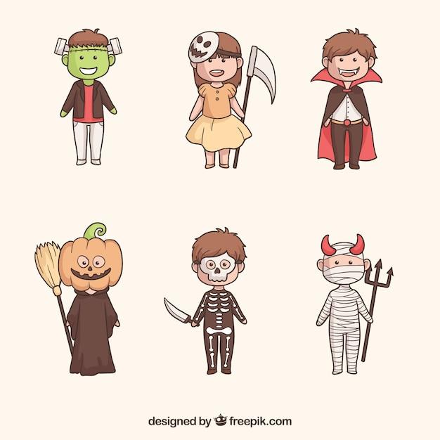 Ensemble amusant d'enfants effrayants d'halloween Vecteur gratuit
