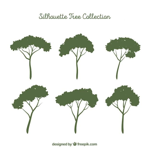 Ensemble d'arbres avec silhouette Vecteur gratuit
