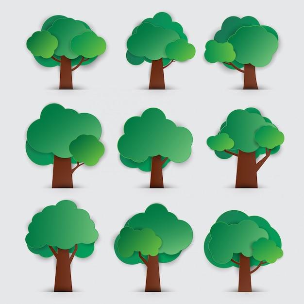 Ensemble d'arbres avec style de papier découpé Vecteur Premium