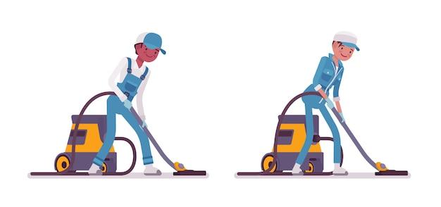Ensemble d'aspirateur de concierges masculin et féminin Vecteur Premium