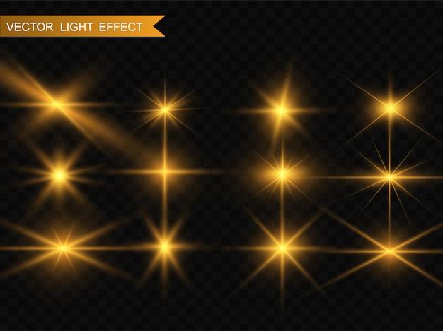 Ensemble De Belles étoiles Brillantes D'or. Effet Lumineux Bright Star. Belle Lumière Pour Illustration. étoile De Noël. Des étincelles Blanches Scintillent D'une Lumière Spéciale. Vecteur Scintille Sur Fond Transparent Vecteur Premium