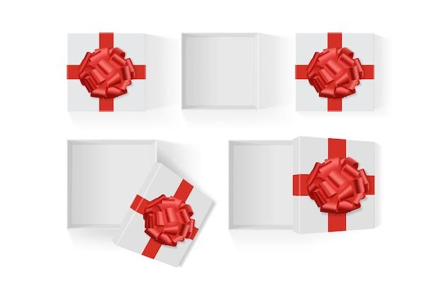 Ensemble De Boîtes Blanches Ouvertes Avec Un Grand Noeud Cadeau Rouge Sur Un Modèle De Fond Blanc Vecteur Premium