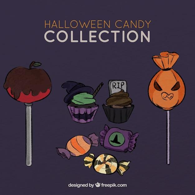 Ensemble de bonbons savoureux pour halloween Vecteur gratuit
