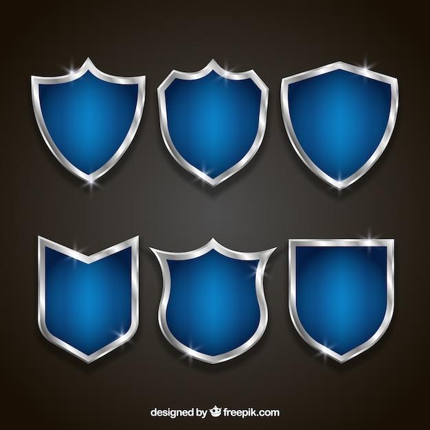 Ensemble de boucliers élégants bleu et argent Vecteur gratuit