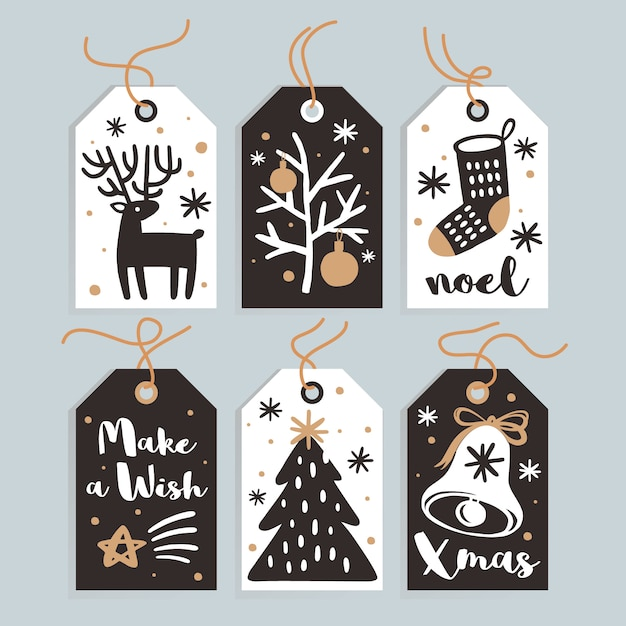 Ensemble de cartes et d'étiquettes de cadeaux de noël mignons Vecteur Premium