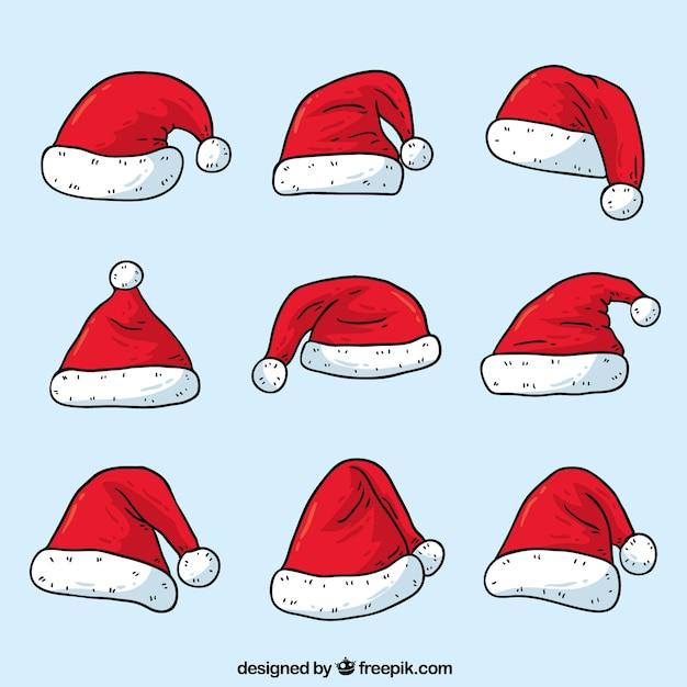 Ensemble De Chapeaux De Père Noël Dessinés à La Main Vecteur gratuit