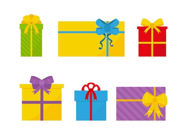 Ensemble de coffrets cadeaux plat coloré avec des arcs. Vecteur Premium