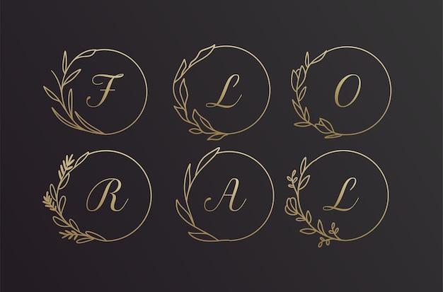 Ensemble De Conception De Cadre De Logo De Couronne De Fleurs D'alphabet Dessiné à La Main Noir Et Or Floral Vecteur Premium