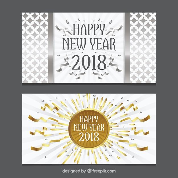 ensemble de deux cartes de voeux de nouvel an en or et argent t l charger des vecteurs. Black Bedroom Furniture Sets. Home Design Ideas