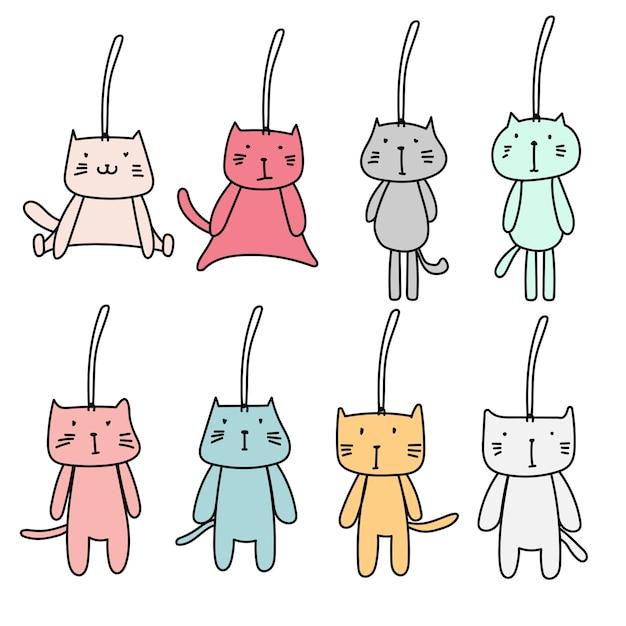 Ensemble dessiné à la main de trousseau de chat mignon Vecteur Premium