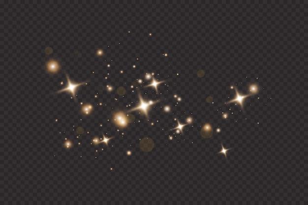 Ensemble D'effets De Lumières Rougeoyantes Dorées Isolés Sur Fond Transparent. Sun Flash Avec Des Rayons Et Des Projecteurs. Effet De Lumière éclatante. L'étoile A éclaté D'étincelles. Vecteur Premium